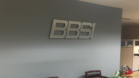 acrylic with brushed aluminum dibond and vinyl letter overlay