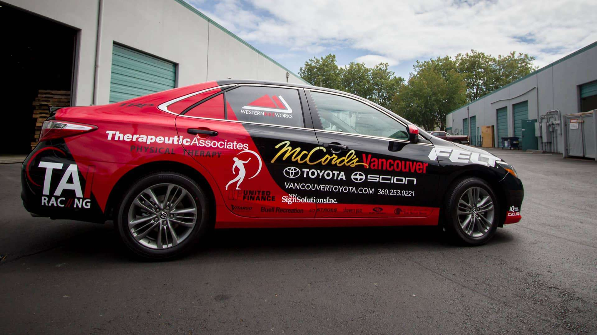 TAI Racing Cycling Team graphics partial wrap on a 2016 Toyota Camry